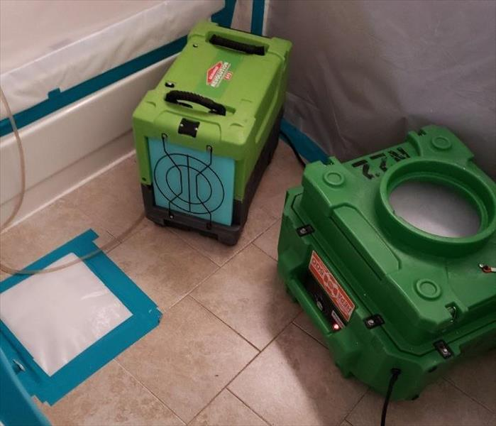 Two dehumidifiers in a bathroom