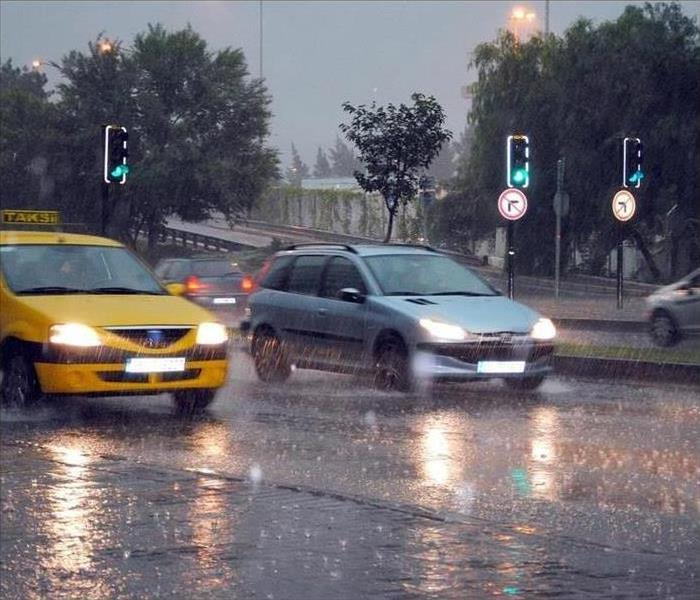 Cars driving along a wet road in the rain
